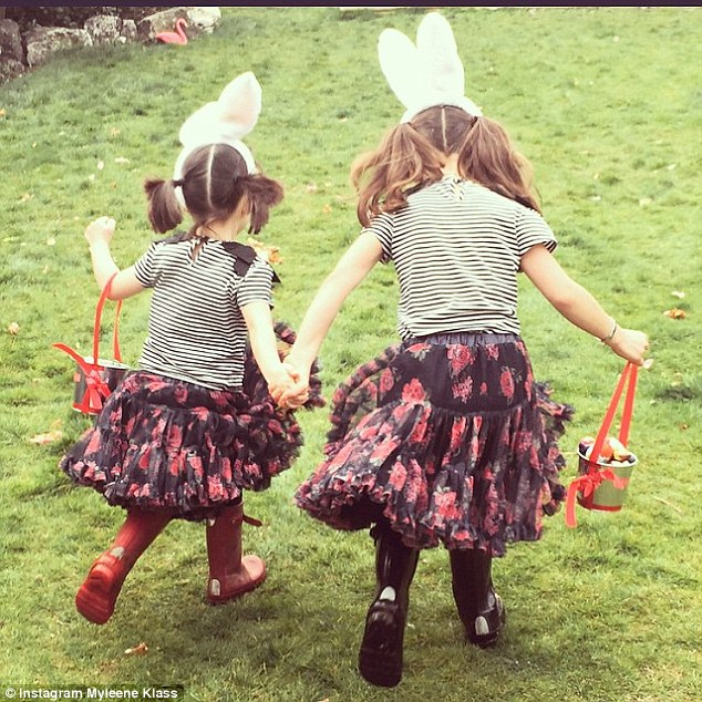 Myleene Klass posted this adorable snap on Instagram of her daughters Ava (right), 8,  and Hero (left), 4, setting off on an Easter egg hunt around the garden in matching outfits and cute bunny ear headbands