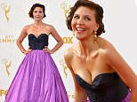 Maggie Gyllenhaal arrives at the 67th Primetime Emmy Awards on Sunday, Sept. 20, 2015, at the Microsoft Theater in Los Angeles. (Photo by Jordan Strauss/Invision/AP)