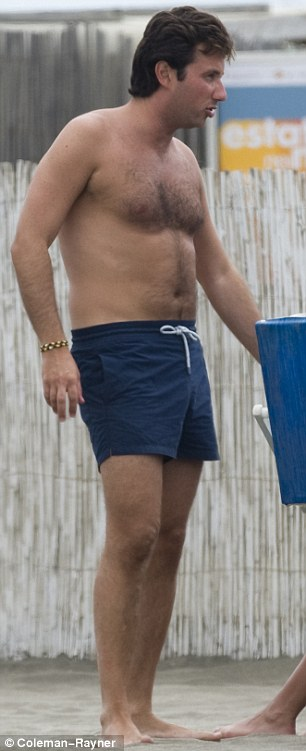 Beach bodies: Raffaello strutted around in a pair of Navy blue shorts while his new lady slipped into a peach swimsuit