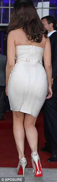 If you've got it, flaunt it: Kelly Brook was keen to show off her shapely rear as she arrived at the Samsung bash at London's exclusive One Mayfair venue