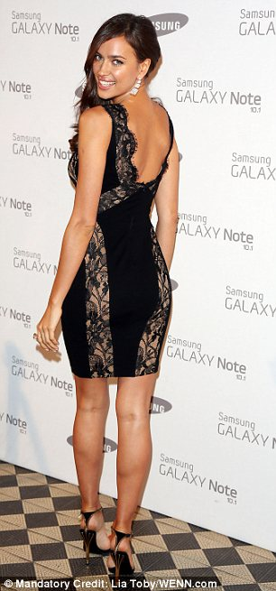 She's got lace: Irina Shayk brought sexy back in a black lace panelled bodycon dress