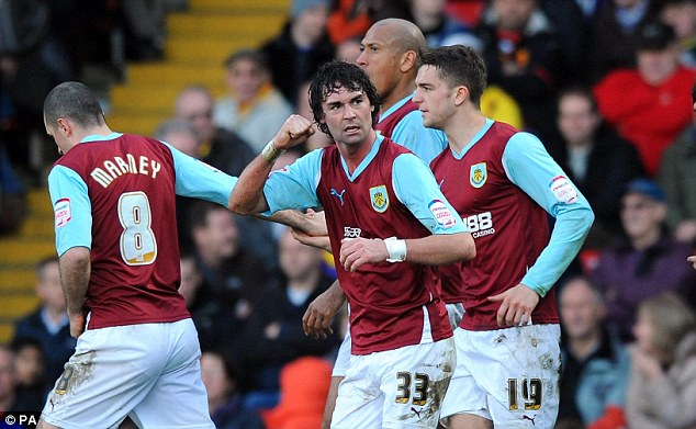 In form: Chris Eagles celebrates scoring Burnley's second goal in their 3-1 win at Watford earlier this month