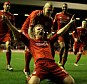 Pure delight: Dirk Kuyt celebrates his late winner at Anfield