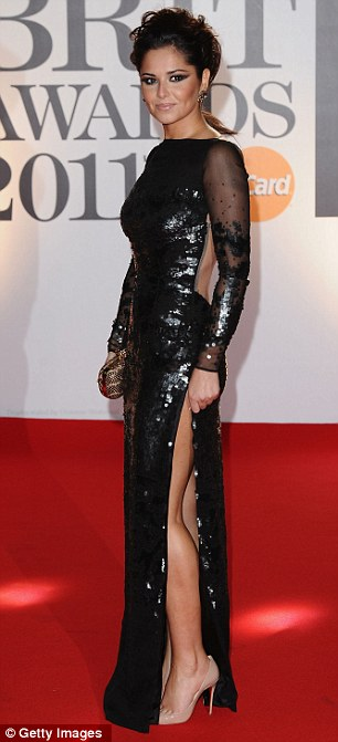 Singer Cheryl Cole arrives on the red carpet for The BRIT Awards 2011 at the O2 Arena