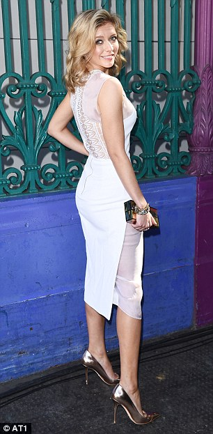 Elsewhere, Rachel Riley turned heads in a sheer-panelled white dress