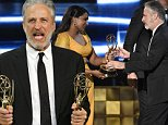 Mindy Kaling, right, presents Jon Stewart the award for outstanding writing for a variety series for ìThe Daily Show With Jon Stewartî at the 67th Primetime Emmy Awards on Sunday, Sept. 20, 2015, at the Microsoft Theater in Los Angeles. (Photo by Chris Pizzello/Invision/AP)