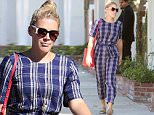 Busy Phillips was spotted while out and about in Beverly Hills.  The actress was dressed in a singular design, with movie star shades, on Saturday, September 19, 2015. X17online.com