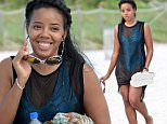 142700, Angela Simmons enjoys an afternoon on the beach in Miami. The 28 year old designer wore a blue snakeskin print one piece under a black see-through dress, and a pair of kitty sunglasses. After soaking up some rays, Angela hit the jet skis, taking one for a whirl about in the ocean. Miami, Florida - Sunday September 20, 2015. Photograph: Brett Kaffee/Thibault Monnier, © Pacific Coast News. Los Angeles Office: +1 310.822.0419 sales@pacificcoastnews.com FEE MUST BE AGREED PRIOR TO USAGE