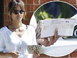 19.SEPT.2015 -   LOS ANGELES - USA\n** EXCLUSIVE ALL ROUND PICTURES **\nHOLLYWOOD ACTRESS HALLE BERRY AND HUSBAND OLIVIER MARTINEZ RETURN TO THEIR CAR TO FIND PARKING TICKET IN LSO ANGELES\nBYLINE MUST READ:  XPOSUREPHOTOS.COM\n**NOT AVAILABLE FOR GERMANY, AUSTRIA OR SWITZERLAND**\n***UK CLIENTS - PICTURES CONTAINING CHILDREN PLEASE PIXELATE FACE PRIOR TO PUBLICATION ***\n**UK AND USA CLIENTS MUST CALL PRIOR TO TV OR ONLINE USAGE PLEASE TELEPHONE 0208 344 2007*