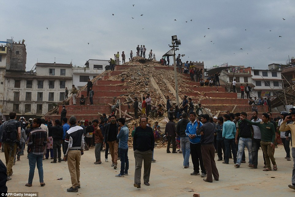 Crowds gather round the temple in Bashantapur Durbar Square which was badly damaged but has managed to stay mostly upstanding after the tremor