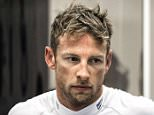 McLaren Honda's British driver Jenson Button is seen in the garage during the free practice session of the Formula One Singapore Grand Prix in Singapore on September 18, 2015. AFP PHOTO / Philippe LopezPHILIPPE LOPEZ/AFP/Getty Images