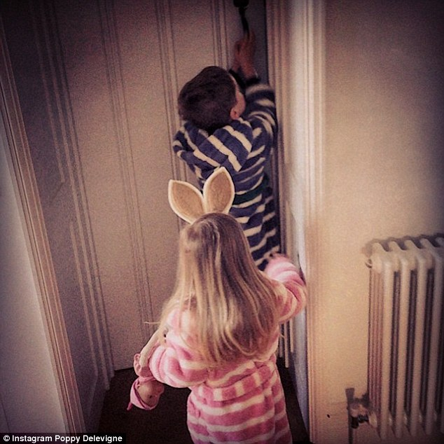Show us the eggs! Model Poppy Delevingne shared this family snap of her niece and nephew excitedly waking up the house