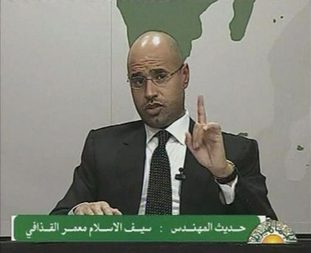 Defiant: Saif al-Islam, son of Libyan leader Muammar Gaddafi, said he would would enforce security at any price as unrest continues