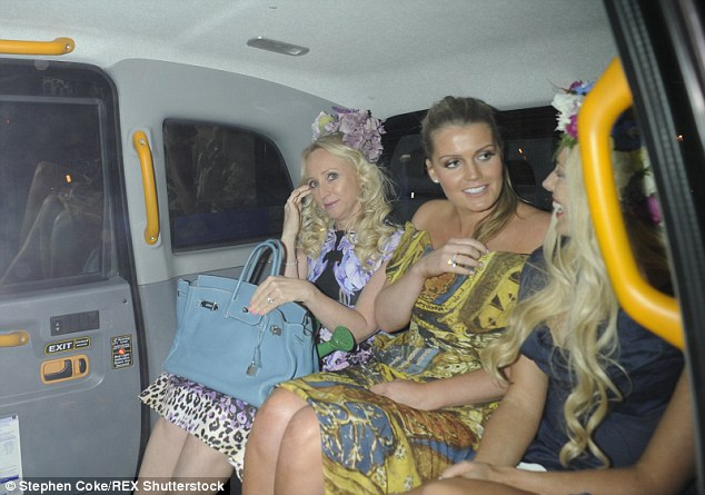 Kitty Spencer is seen leaving the event with pals in the back of a cab