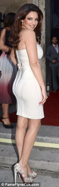 If you've got it, flaunt it: Kelly Brook was keen to show off her shapely rear as she arrived at the bash