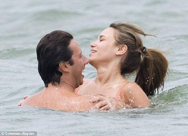 Making a splash: Follieri laughed away as Tina showered him with kisses and hugs
