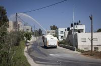 The army spraying the Skunk liquid into homes in Nabi Saleh, West Bank | 20 April 2012 | Photographed by ActiveStills