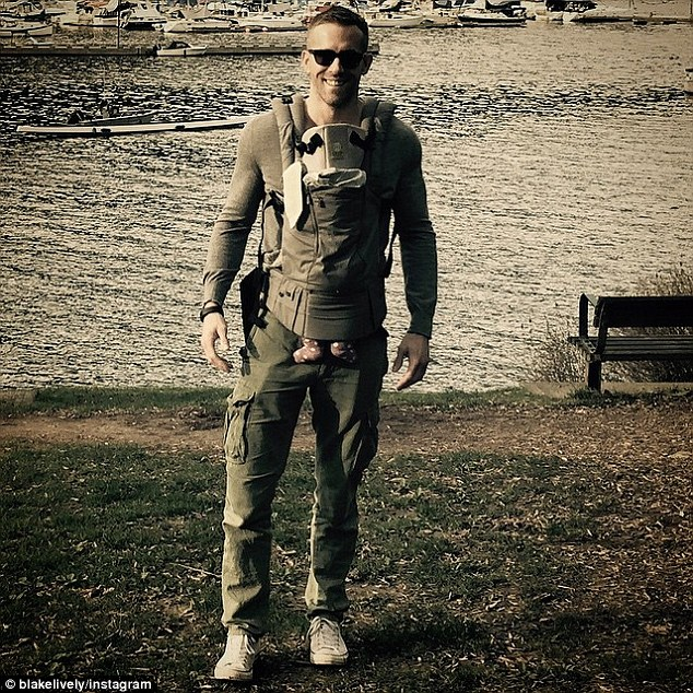 Private pics: Very few pictures have been shared of James - and this one, which Blake Lively posted on Instagram for Father's Day, received criticism for the way Ryan has 'incorrectly' positioned the baby