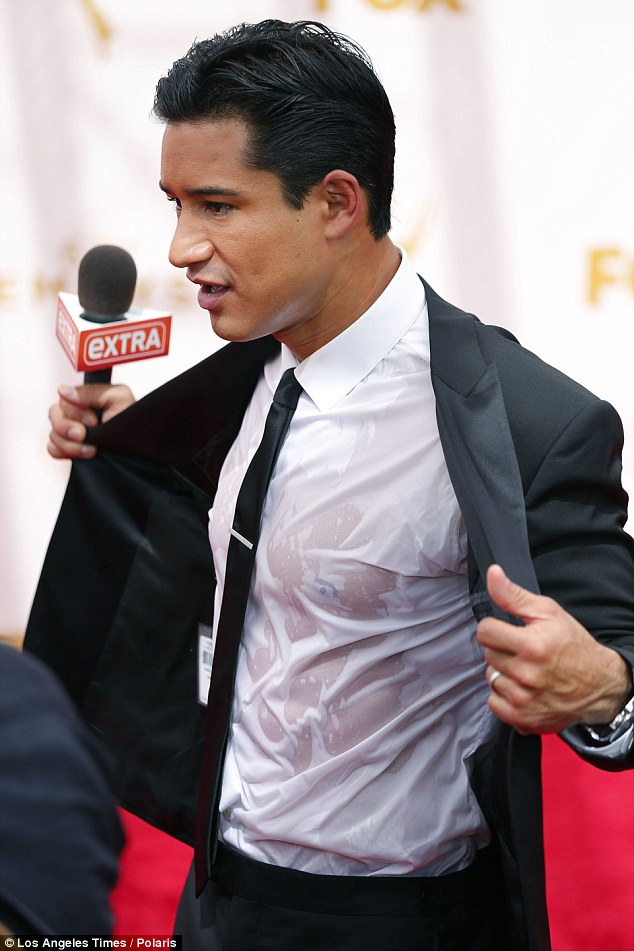 Extra hot: Mario Lopez was swearing so much he had to change shirts on the Emmy red carpet on Sunday