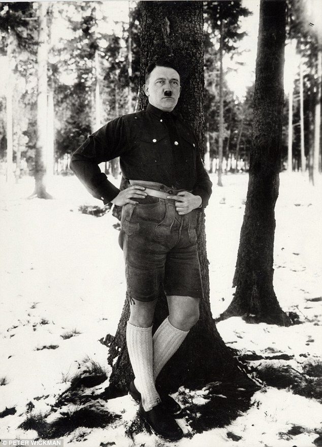 In lederhosen and knee-high socks, Adolf Hitler lounges against a tree. The Fuhrer later banned the absurdly camp woodland snap, calling it 'beneath one's dignity'