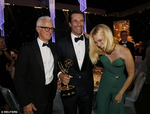 They're all here: Hamm (C) holds his award for Outstanding Lead Actor in a Drama Series for his role on AMC's Mad Men while mingling with actors John Slattery and Jones at the 67th Annual Primetime Emmy Awards Governors Ball