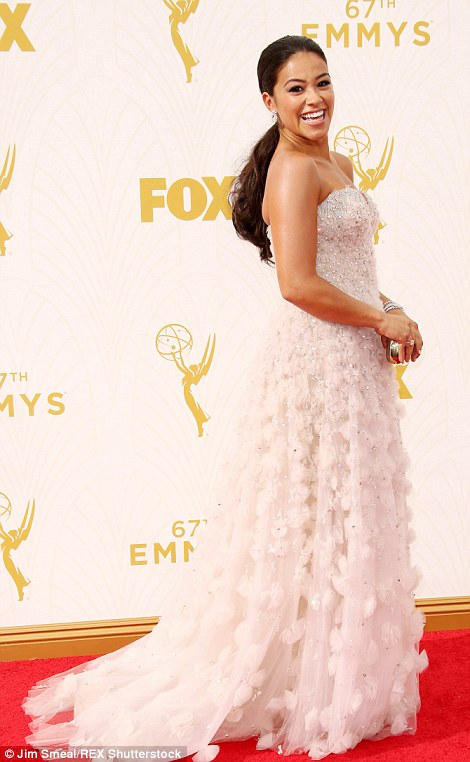 All about the trains: Downton Abbey star Joanne Froggatt opted for a beautiful blush pink and black while Jane The Virgin actress Gina Rodriguez went for all-out texture
