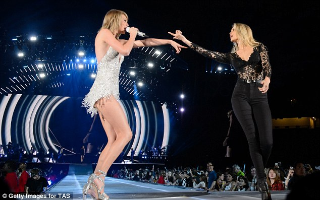 Gigi, right, joined Taylor on stage in Detroit this weekend.Gigi is fast becoming one of the most famous names in Hollywood and is currently riding high as one of the most popular models