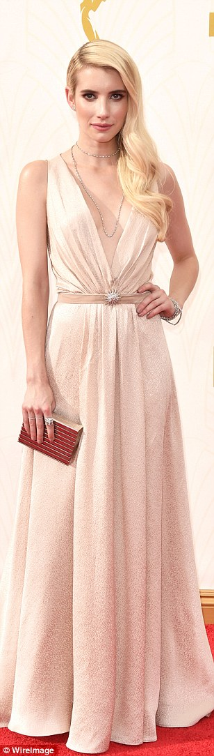 Old Hollywood: Emma Roberts wore a daring plunging gown in a soft pastel hue with shimmery sheen
