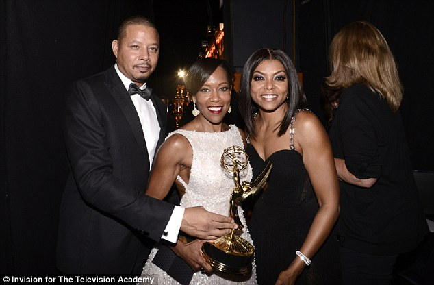 Happy: Regina couldn't stopped smiling as she posed with her award and the presenters, Taraji and Terrence Howard, left