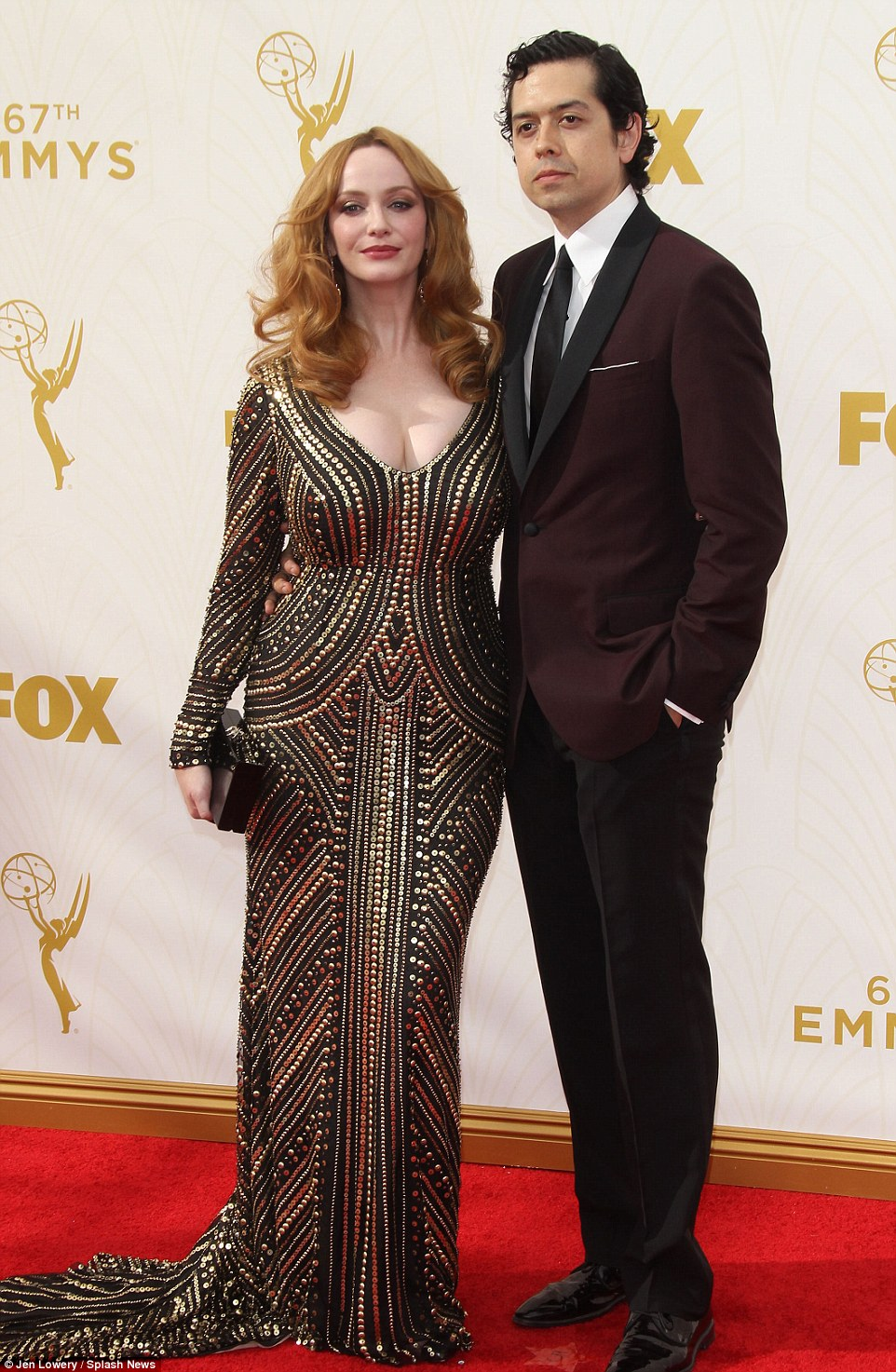 Glam in gold: Christina wowed as she took to the red carpet with husbandGeoffrey Arend