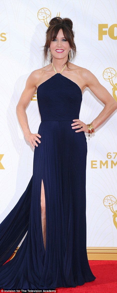 Revealing:Actress Christine Marzano wore a striking sheer dress with glittery geometric pattern while newly brunette Felicity Huffman stunned in midnight blue