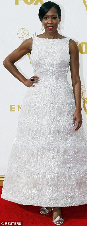 Elegant: Regina glowed in a textured white dress she teamed with silver shoes and bold dangling earrings