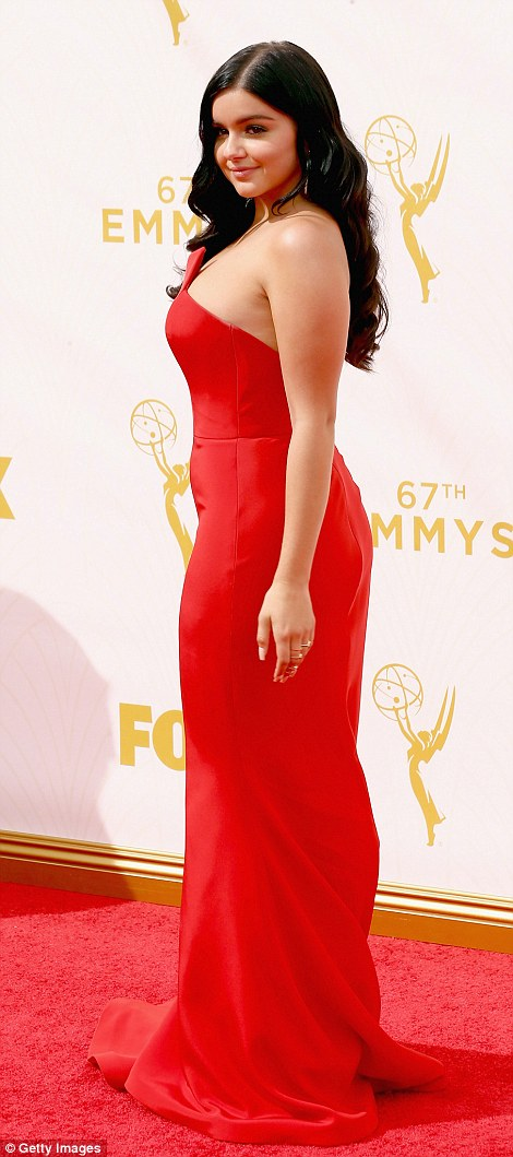 Lady in red: The 17-year-old Modern Family beauty wore a scarlet red strapless gown and wore her raven tresses in glamorous curls