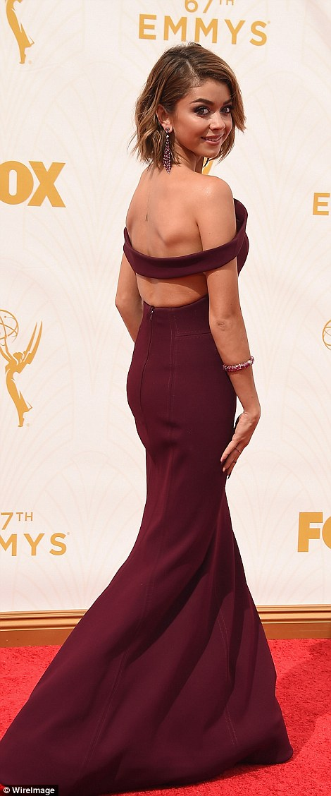 Ravishing in red: The Modern Family star showed off much of her back in the Zac Posen gown which featured a fishtail skirt