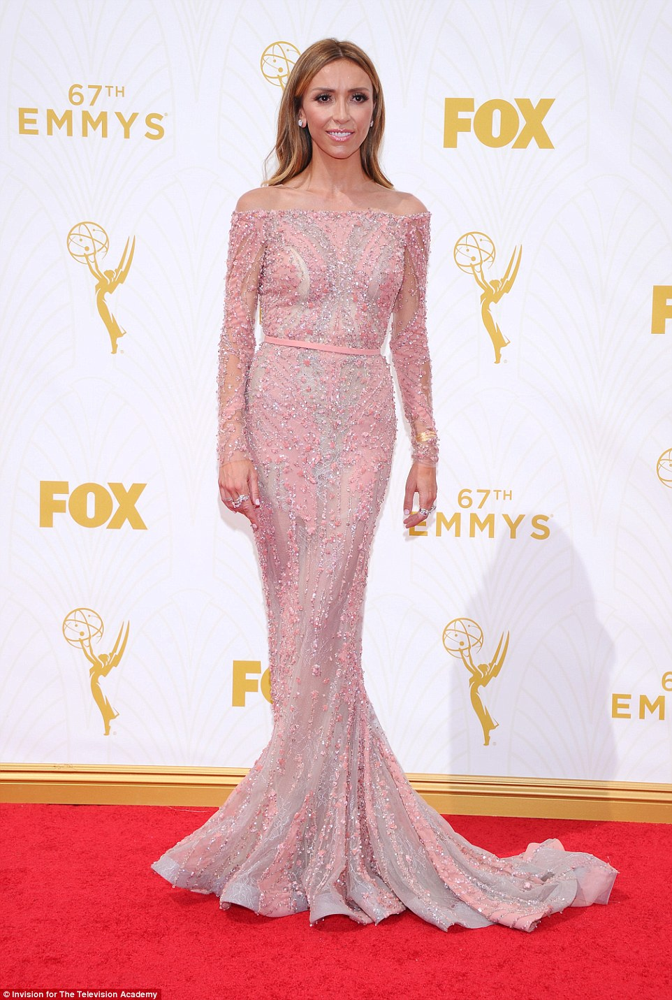 Like a tall drink of pink: Giuliana Rancic of E! wore a long, mermaid finish crystal embellished gown and several diamond rings