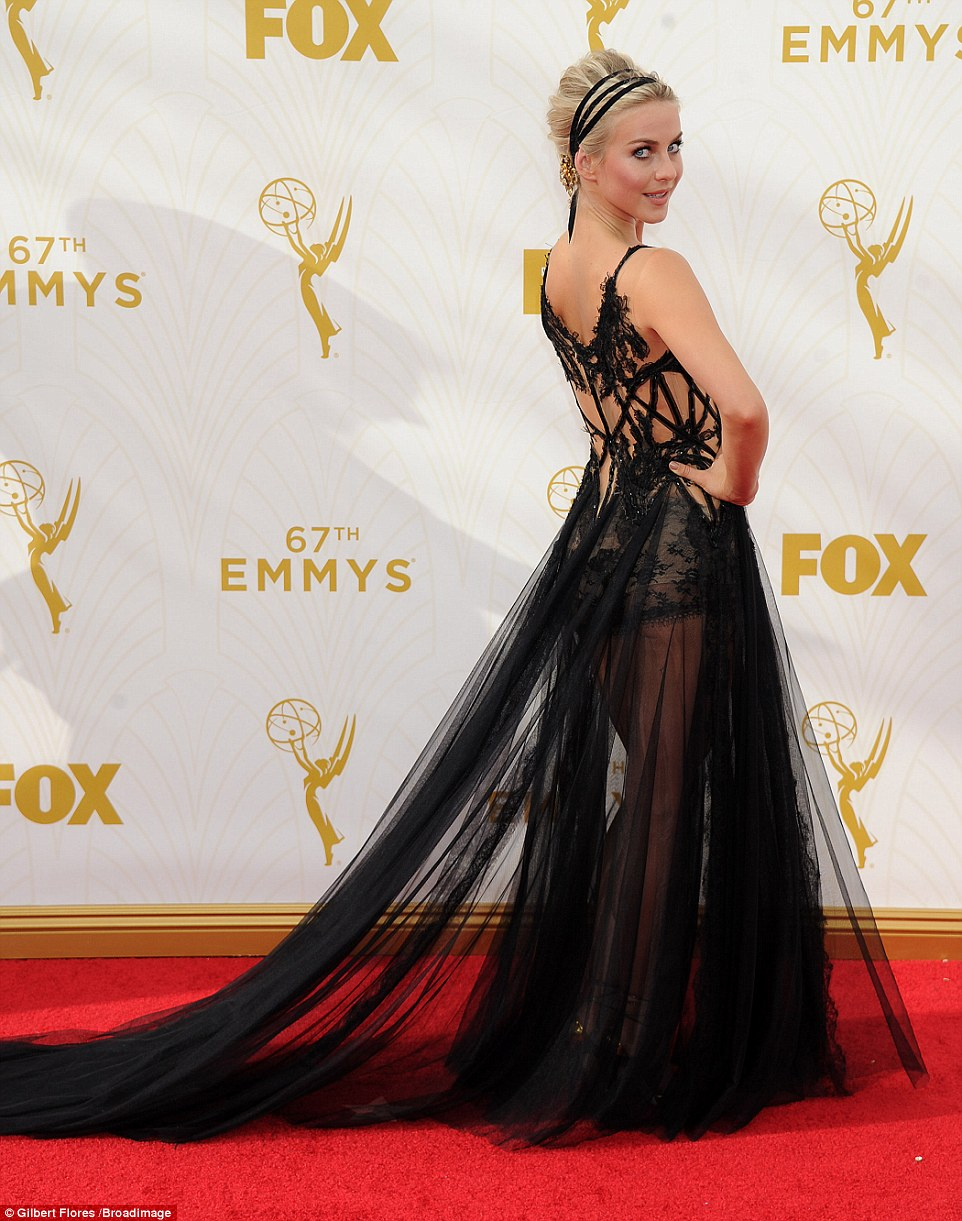 Vamping it up! Julianne Hough flashed the flesh in a long and sheer black dress that skimmed the red carpet