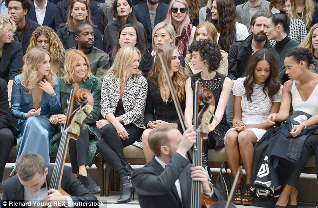 Suki Waterhouse, Sienna Miller, Kate Moss, Cara Delevingne, St. Vincent and Naomie Harris made up the star-studded front row