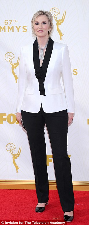 Black and white: Jane Lynch opted for her go-to trouser suit style, while Regina King andLaila Robins went for classic glamour