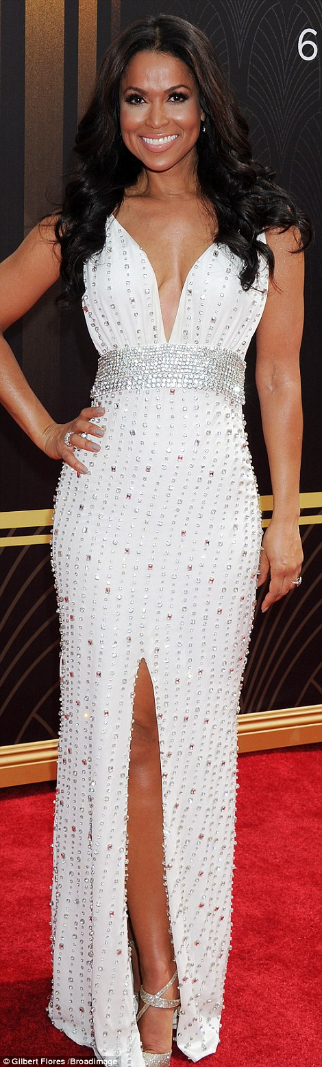 Bit of all white: Extra's Tracey Edmonds stunned in a jeweled white gown with empire waist