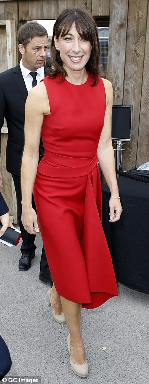 Happy: The Prime Minister's wife looked ravishing in red as she made her way into the venue with a huge smile on her face