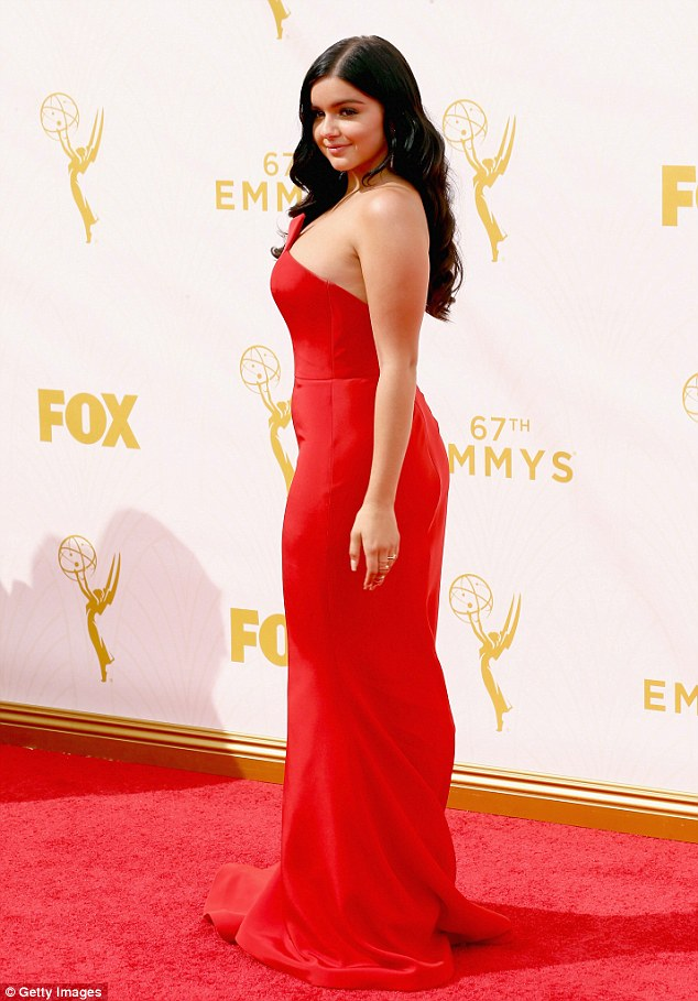 A pro with the poses:The 17-year-old Modern Family star stunned in a red sleeveless dress with an asymmetrical accent that spelled fashion forward