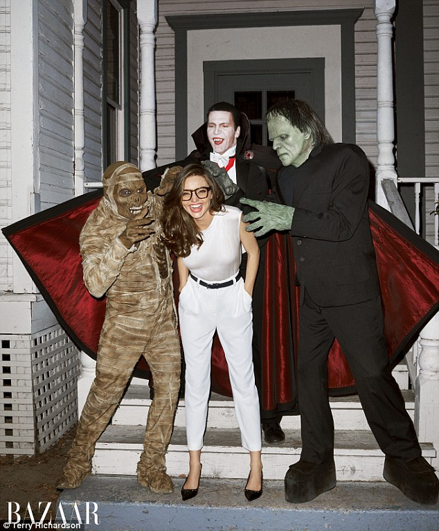 Monster Mash: The Australian beauty laughed in Gucci glasses and white Giorgio Armani separates, as Dracula, Frankenstein, and a zombie tried to give her a scare
