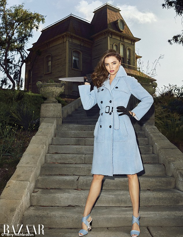 Killer style: Miranda Kerr, 32, wields a knife, while modeling a Fendi trench coat and matching sandals in a new Halloween-themed photo shoot for Harper's Bazaar