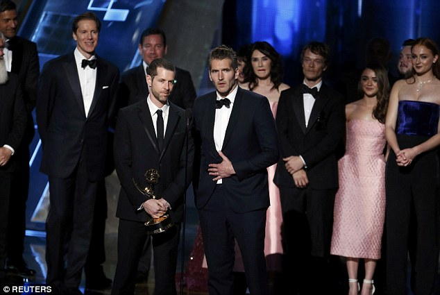 They are all here! D.B. Weiss and David, with cast and crew, accept the award for Outstanding Drama Series