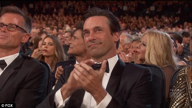 Caught: Sofia Vergara (left) was spotted eating popcorn during the Emmy Awards on Sunday - right as Jon Hamm's name was announced as an Outstanding Drama Actor nominee