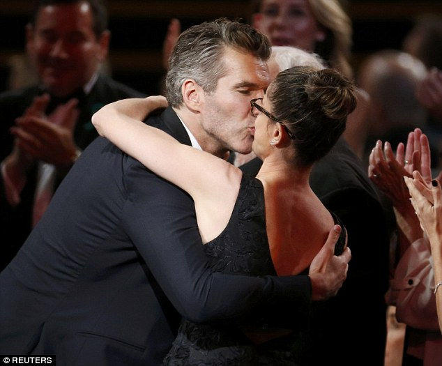 In love:When David Benioff was announced as the winner of Outstanding Drama Series for Game Of Thrones, he turned to his wife Amanda Peet for a big kiss