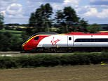 Virgin Trains Pendolino electric train at speed between Coventry and Rugby, Warwickshire, England, UK. Image shot 2006. Exact date unknown.
