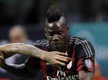 AC Milan's Mario Balotelli, right, challenges for the ball with Palermo's Aljaz Struna during the Serie A soccer match between AC Milan and Palermo at the San Siro stadium in Milan, Italy, Saturday, Sept. 19, 2015. AC Milan beat Palermo 3-2 for only its second win of the season as the visiting side missed the chance to move provisionally top of Serie A on Saturday. (AP Photo/Antonio Calanni)