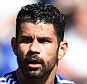 epa04938339 Chelsea's Diego Costa (R) has an altercation with Gabriel Paulista (C) resulting in Gabriel being sent off during the English Premier League soccer match between Chelsea FC and Arsenal FC at Stamford Bridge in London, Britain, 19 September 2015.  EPA/ANDY RAIN EDITORIAL USE ONLY. No use with unauthorized audio, video, data, fixture lists, club/league logos or 'live' services. Online in-match use limited to 75 images, no video emulation. No use in betting, games or single club/league/player publications.