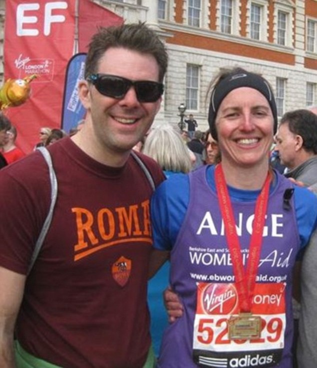 Happy days: Angela Field with her husband Elliot after the 2013 London Marathon